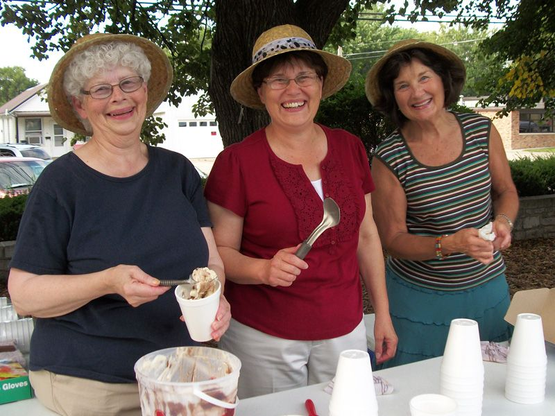 Friends members serve ice cream at the summer reading club concert